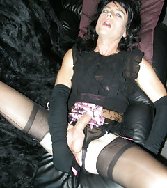 Filthy dark haired crossdresser enters the house then masturbates her hard cock all over the sofa